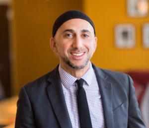 headshot of rami nashashibi, smiling